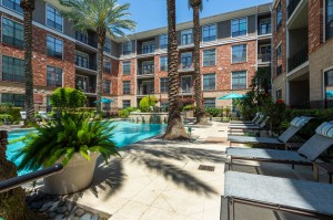 One Bedroom Apartments for Rent in Houston, TX - Up Close Pool Area & Lounge Chairs